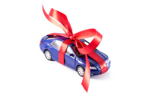 car with red ribbon